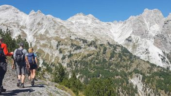 Trekkers walking the Valbona Pass